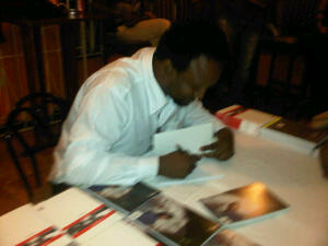 Ruel Johnson signing a copy of Fictions